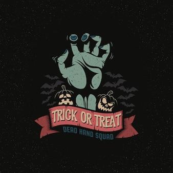 Tote hand des zombies mit trick oder leckerei auf band. halloween-thema