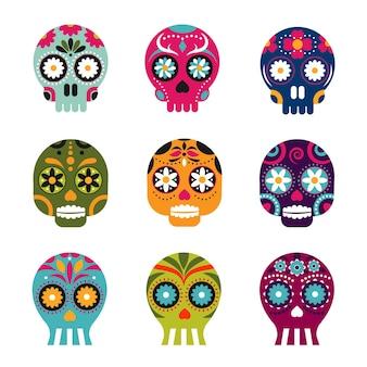 Tote köpfe des mexikanischen skeletts mit blumen besetzt