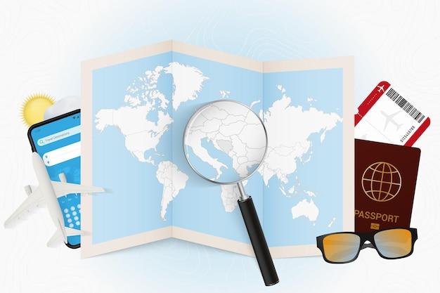 Tourismusmodell des reiseziels bosnien und herzegowina mit reiseausrüstung und weltkarte