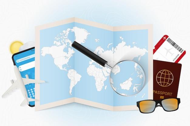 Tourismusmodell des reiseziels brunei mit reiseausrüstung und weltkarte