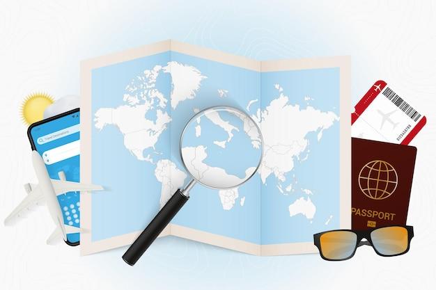 Tourismusmodell des reiseziels malta mit reiseausrüstung und weltkarte