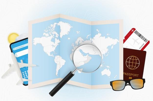 Tourismusmodell des reiseziels oman mit reiseausrüstung und weltkarte
