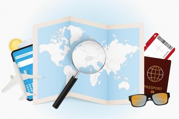Tourismusmodell des reiseziels schweiz mit reiseausrüstung und weltkarte