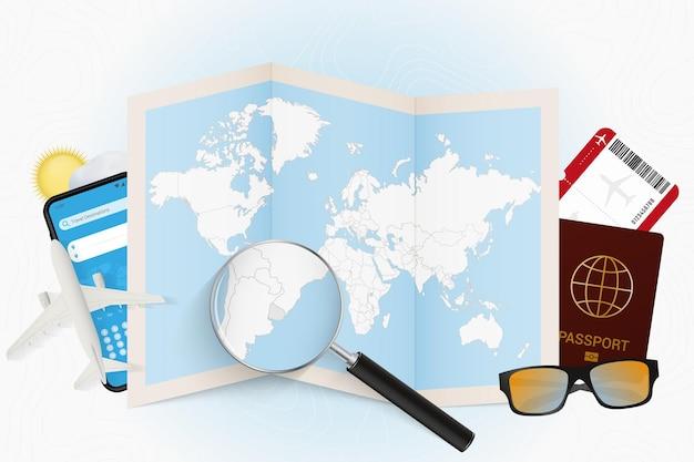 Tourismusmodell des reiseziels uruguay mit reiseausrüstung und weltkarte