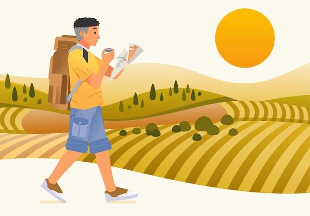 Touristischer charakter des jungen mannes, der rucksack und karte bringt, die entlang der grünen wiese gehen