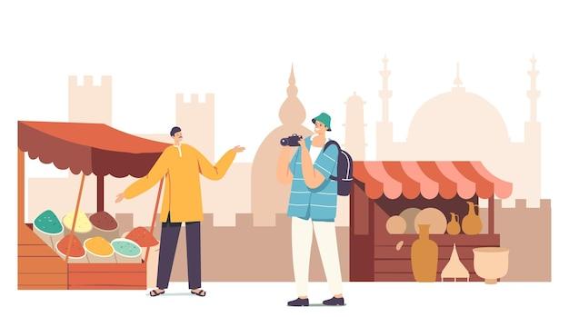 Touristischer männlicher charakter mit fotokamera, der beim besuch des muslimischen arabischen marktes aufnahmen macht