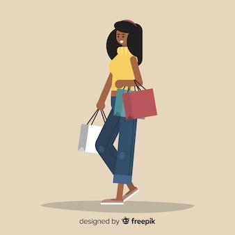 Tragende einkaufstaschen der glücklichen frau