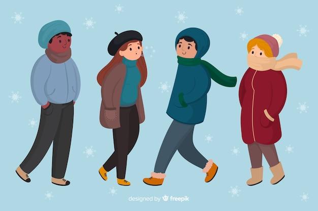 Tragende winterkleidung der leute an einem schneebedeckten tageshintergrund