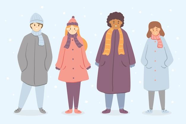 Tragende winterkleidung der leute auf blauem hintergrund