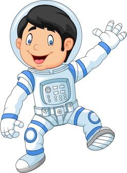 Tragender astronautenkostüm der karikatur kleiner junge