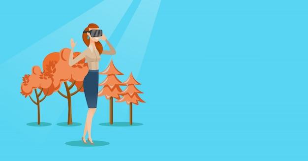 Tragender kopfhörer der virtuellen realität der frau im park