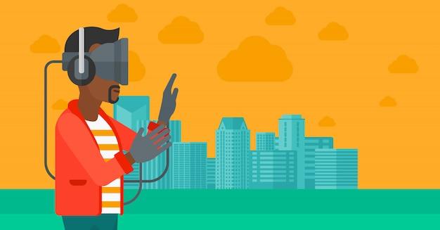 Tragender kopfhörer der virtuellen realität des mannes