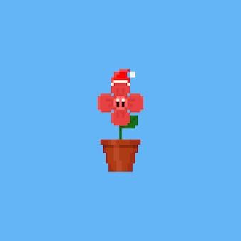 Tragender weihnachtshut der netten blume der pixel