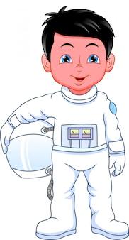 Tragendes astronautenkostüm des kleinen jungen der karikatur
