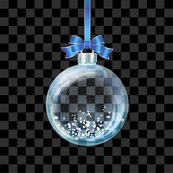 Transparente weihnachtskugel aus glas mit schnee im inneren