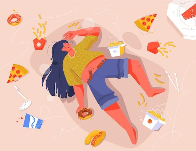 Traurige dicke frau, die fast food isst und auf dem boden liegt