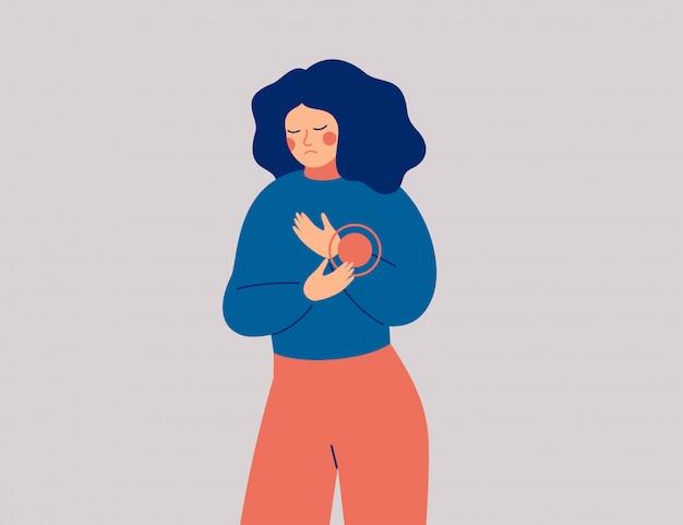 Traurige frau hat schmerzen oder beschwerden in der hand. junge weibliche person erlitt eine verletzung am handgelenk.