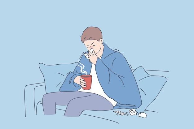 Traurige mannkarikaturfigur, die auf sofa in der warmen decke mit heißem getränk sitzt und sich krank krank fühlt und grippe niest