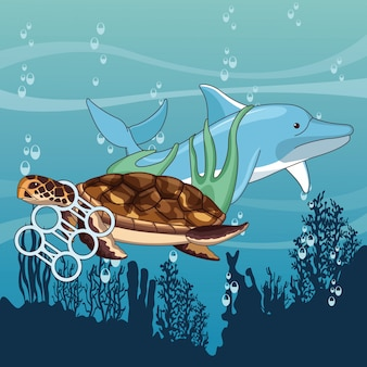 Trauriger delphin und schildkröte fest