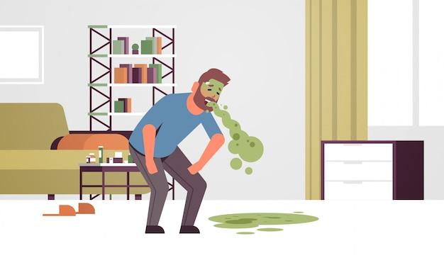 Trauriger kerl erbrechen übelkeit magenschmerzen essen oder alkoholvergiftung verdauungsproblem konzept unglücklicher mann kotzen sich krank krank modernes wohnzimmer interieur horizontal flach in voller länge