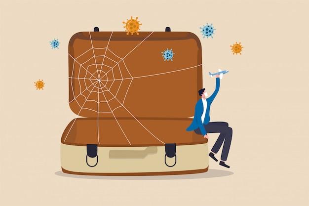 Trauriger mann tourist sitzt auf leerer reisetasche.