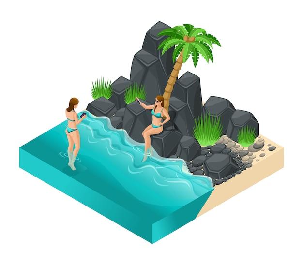 Trendy isometric menschen, mädchen an einem steinstrand in badeanzügen zum sonnenbaden. urlaub, tour, reise, palmenillustration