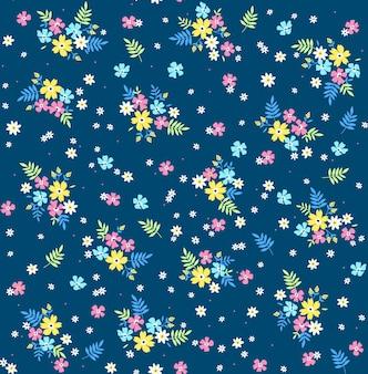 Trendy nahtlose vektor blumenmuster nahtloser druck kleine bunte blumen blauer hintergrund