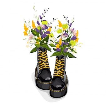 Trendy schwarze stiefel mit gelber schnürung, bunten blumen, isoliert