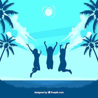 Triopischer strand und glückliche frauen springen