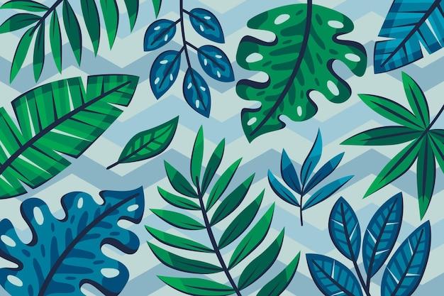 Tropische blätter mit geometrischem hintergrundkonzept