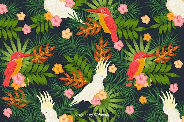 Tropische blätter und hintergrund der exotischen vögel