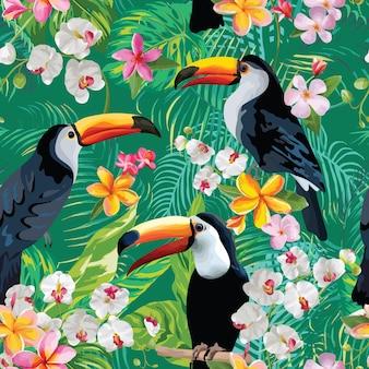 Tropische blumen und tukan-vögel-weinlese-hintergrund. nahtloses sommermuster