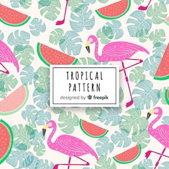 Tropischer musterhintergrund mit flamingo