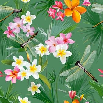 Tropisches nahtloses blumenmuster mit libellen Premium Vektoren