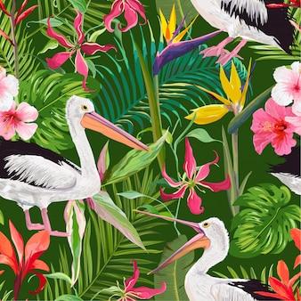 Tropisches nahtloses muster mit pelikanen und blumen