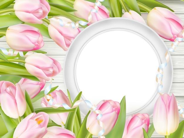 Tulpen und leerer weißer rahmen.