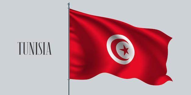 Tunesien wehende flagge auf fahnenmast.