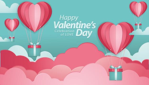 Typografie des glücklichen valentinstags mit heißluftballons der roten herzform des papierschnitts, die im weißen hintergrund fliegen.
