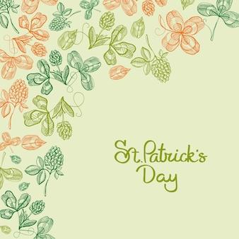 Typografie design gekritzelkarte mit inschrift über st. patricks day und orange und grüne bilder von klee, hopfen, blüte vektor-illustration
