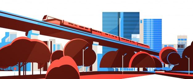 U-bahn-einschienenbahn über stadtwolkenkratzeransicht-stadtbild