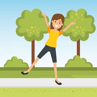 Übender sport der jungen frau im park