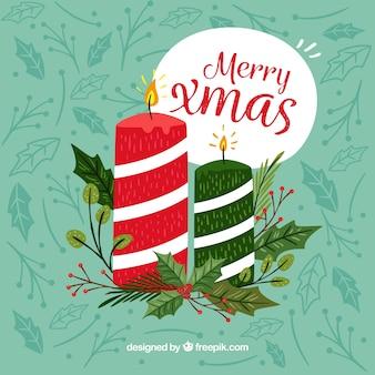 Übergeben sie gezogenen hintergrund mit den roten und grünen weihnachtskerzen