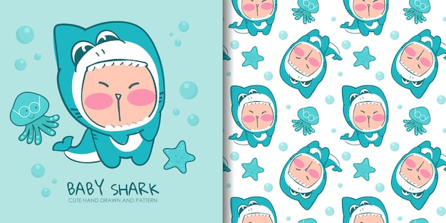 Übergeben sie gezogenes reizendes kind im kostüm des haifischs mit nahtlosem muster