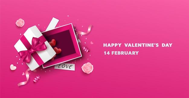 Überraschen sie weiße geschenkbox mit rosa band und herzballon. öffnen sie die lokalisierte geschenkbox. valentinstag.