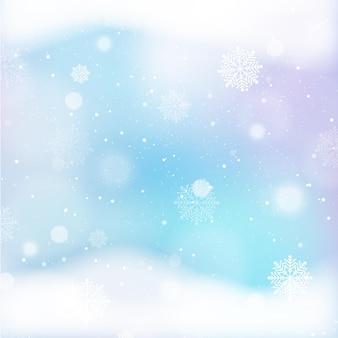 Unfokussierte wintertapete mit schneeflocken
