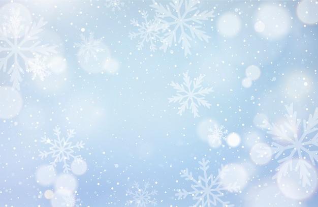 Unfokussierter winterhintergrund mit schneeflocken