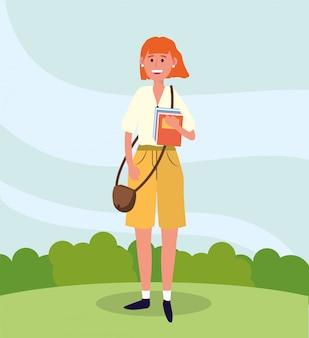Universitätsfrau mit tasche und studienbüchern