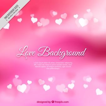 Unscharfe rosa hintergrund mit herzen