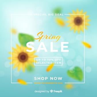 Unscharfer sonnenblumenfrühlingsverkaufshintergrund