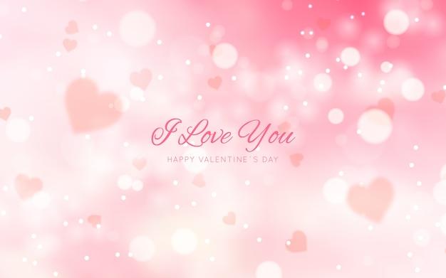 Unscharfer valentinstaghintergrund mit mitteilung